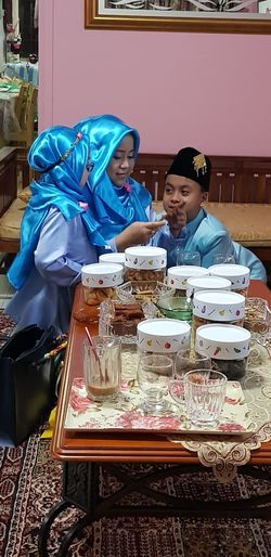 Hari raya celebration. Hijabfashion Togetherness Smiling Child Sari Women Cheerful Young Women Childhood Domestic Life Men Family With Two Children Family Bonds Daughter Mother