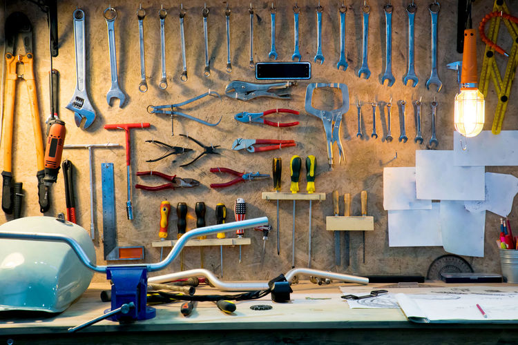 Various Hand Tools Hanging On Pegboard In Workshop