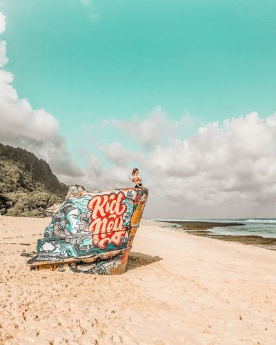 Coastline Ocean Colorful Graffiti Vertical Composition Travel Destinations Bali Tropical Climate Paradise Prestine Beach Secluded Beach Shipwreck Ship Beach Land Sky Water Sea Cloud - Sky Nature One Person Sand Beauty In Nature Real People Outdoors Adult Tranquility Scenics - Nature Women Full Length