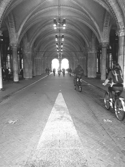 Arch Indoors  Transportation Men Architecture Rear View Built Structure Ceiling The Way Forward Tunnel Full Length Arcade Group Of People Diminishing Perspective Person City Life Corridor Colonnade Archway Architectural Column
