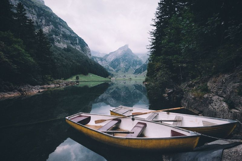 Swiss mountain lake. Switzerland VSCO Adventure Travel Nautical Vessel Boat Transportation Mountain Moored Water Tranquil Scene Tranquility Mode Of Transport Reflection Scenics Solitude Calm Beauty In Nature Waterfront Remote Nature Standing Water Sky Mountain Range