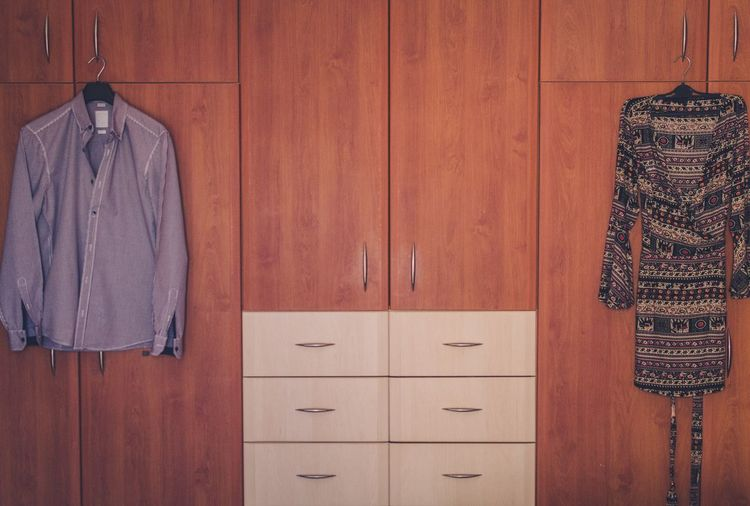 Clothes Hanging On Cabinets At Home