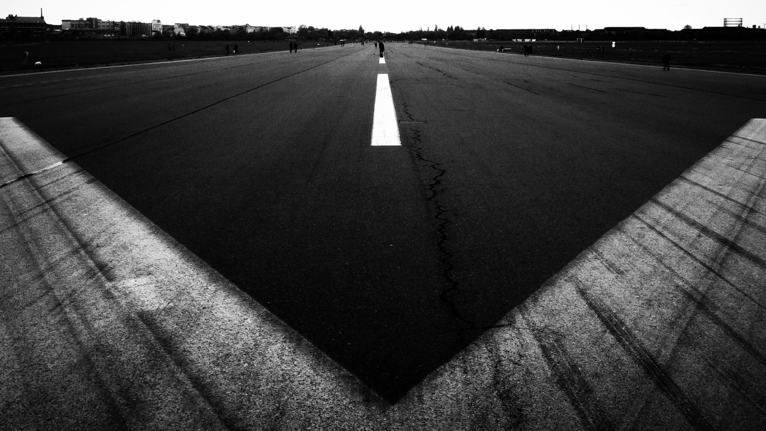 the way forward, road marking, diminishing perspective, transportation, vanishing point, road, asphalt, street, guidance, arrow symbol, direction, empty, surface level, outdoors, day, empty road, in a row, no people, absence, long