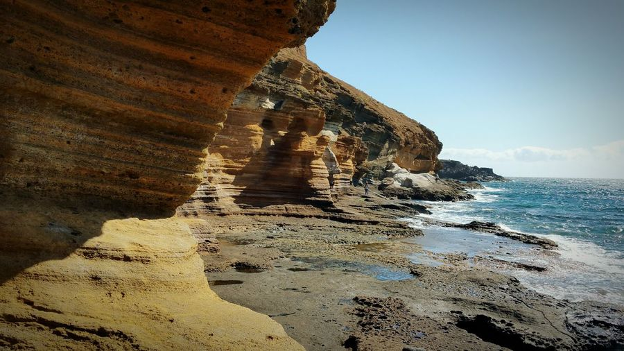 ERODED ROCKY COASTLINE IN A SUNNY DAY