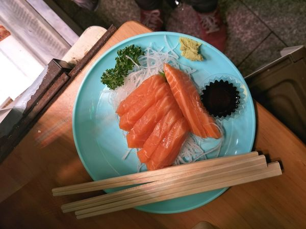 fresh sashimi from the kuromon ichiba market Kuromon Ichiba Market Japan Street Food Tourist Sashimi  Sushi Seafood Plate Japanese Food Raw Food Table Fish Close-up Food And Drink