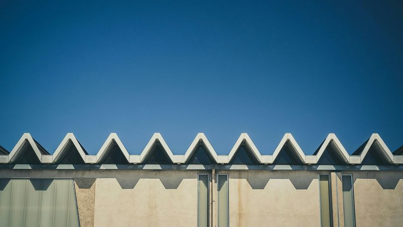 Clear Sky Outdoors Sky Minimalism Photography Eyeemphotography Architecture EyeEm Gallery Building Feature EyeEmBestPics Fine Art Photography EyeEm Best Shots Triangle Shape Shapes And Forms Wall - Building Feature Minimalism Graphic Built Structure Building Exterior Nîmes
