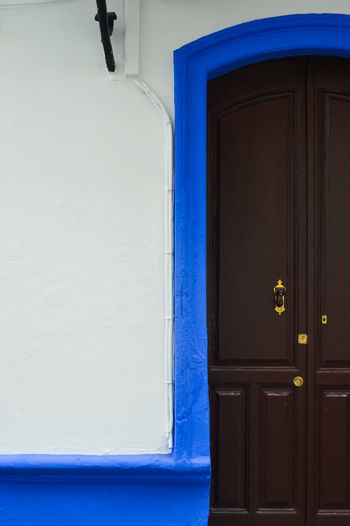 door chasing Outdoors Ayamonte SPAIN Travel Travel Destinations Traveling Door Doorway Doors Pretty Doors Details House Building Exterior Built Structure Building Entrance Architecture Blue No People Closed Day Window Wood - Material Wall - Building Feature Safety Residential District Security Open White Color Blue Color Textured  Texture Man Made Man Made Structure The Mobile Photographer - 2019 EyeEm Awards The Minimalist - 2019 EyeEm Awards The Architect - 2019 EyeEm Awards