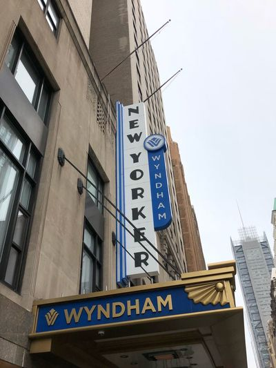 The New Yorker a Wyndham Hotel Wyndham New Yorker Hotel New Yorker Hotel Architecture Building Exterior Built Structure Low Angle View Text Communication Western Script Travel Destinations City Commercial Sign
