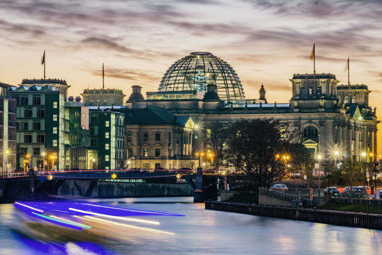Reichstag Building with Spree River at Dusk Berlin Germany 🇩🇪 Deutschland Horizontal No People Outdoors Building Exterior Illuminated Architecture Built Structure City Sky Travel Destinations Building Water Nature Tourism Travel Reichstag Reichstag Building Dusk Sunset Spree River River Cruise Boat Light Trail Blurred Motion