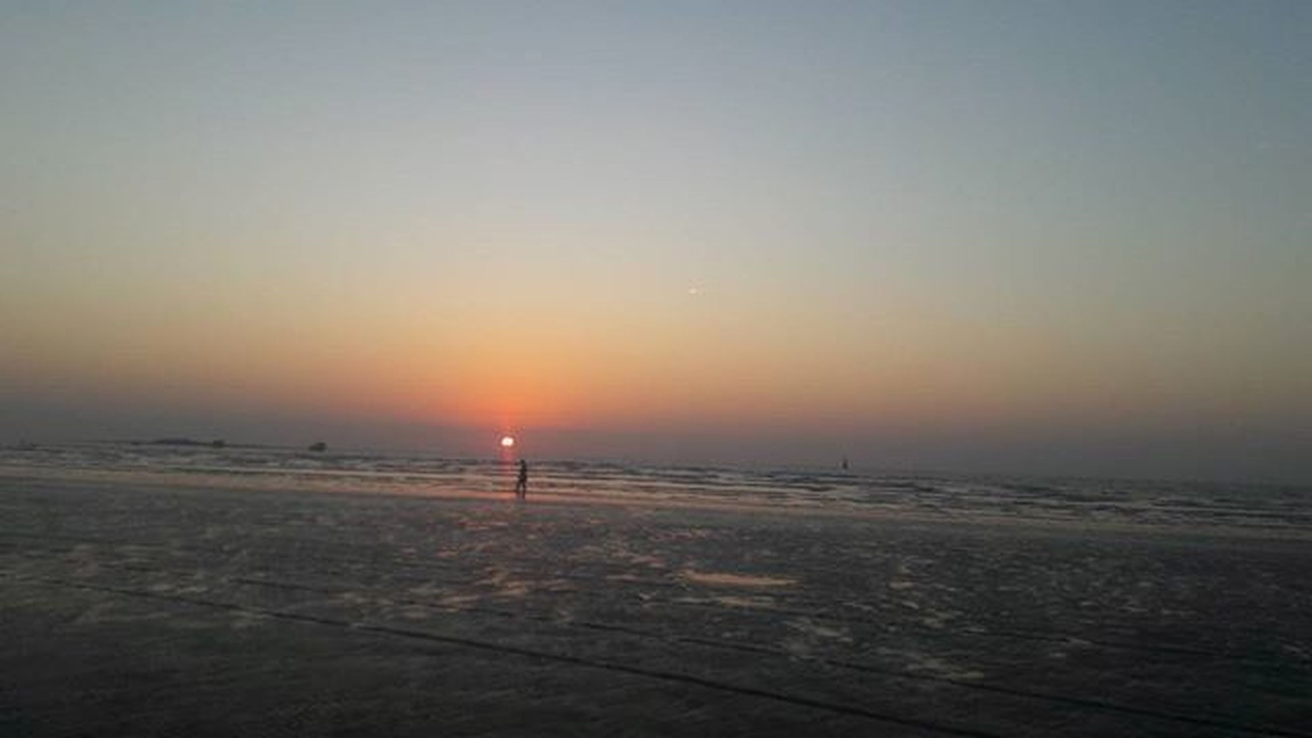 sunset, sea, horizon over water, water, beach, tranquil scene, scenics, tranquility, beauty in nature, shore, orange color, idyllic, nature, sun, copy space, clear sky, sky, sand, remote, silhouette