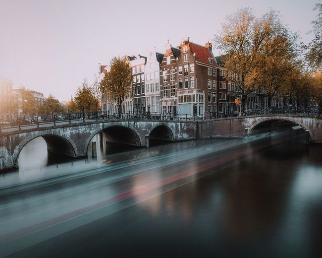 Amsterdam Holland Amsterdam Architecture Built Structure City Tree Building Exterior Sky Nature Water Plant Transportation No People Connection Outdoors Bridge Illuminated Street Bridge - Man Made Structure Motion Long Exposure Autumn Mood