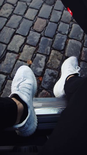 Yeezy Tripple White 350 Mode Fashion Style Yeezy Boost 350 Adidas Yeezy Low Section Human Leg Shoe Real People Body Part Human Body Part Personal Perspective Lifestyles Footpath Casual Clothing