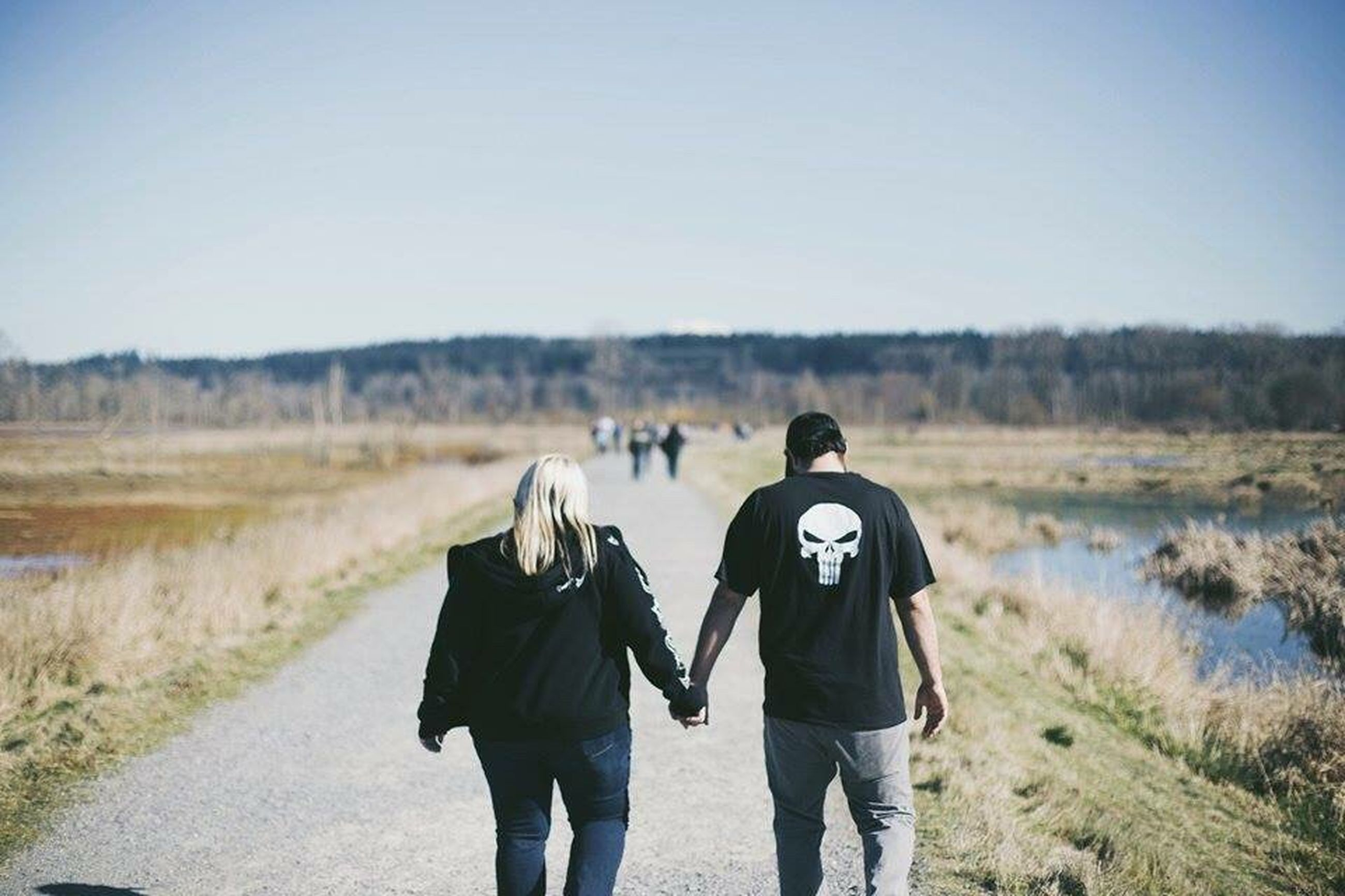 two people, togetherness, rear view, walking, clear sky, outdoors, hiking, adults only, women, friendship, day, winter, sky, cold temperature, adult, people, adventure, nature, young adult, warm clothing, only women