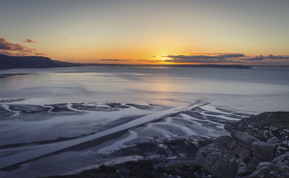 Colorful Sunset over Llandudno Bay at Low Tide Beauty In Nature Cliff Coast Cold Temperature Day Great Orme Headland Horizon Over Water Idyllic Landscape Nature No People Outdoors Scenics Sea Sea And Sky Seaside Shore Sky Sun Sunset Tranquil Scene Tranquility Water Winter