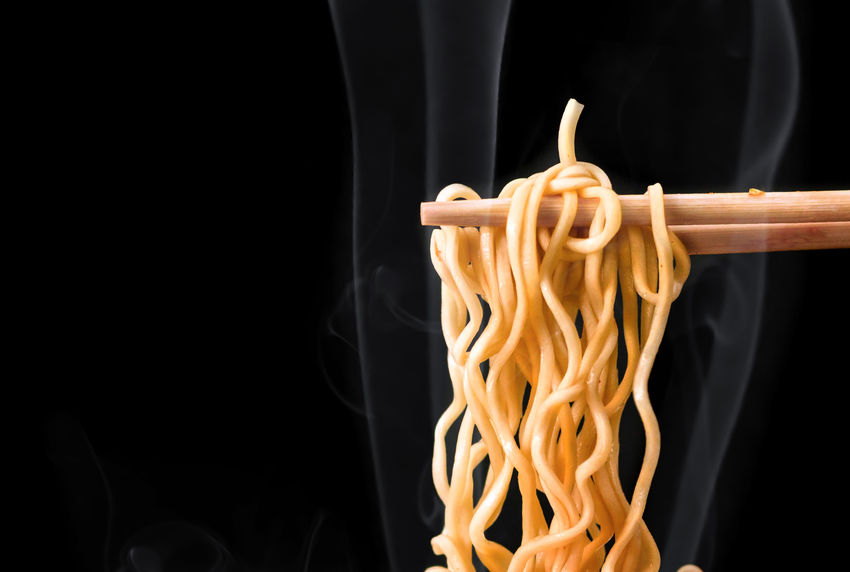 Chopsticks pick up tasty noodles with smoke on dark background. Black Background Pasta Studio Shot Indoors  Food Italian Food Spaghetti Food And Drink Close-up Asian Food Freshness Heat - Temperature Chopsticks Kitchen Utensil Copy Space No People Chinese Food Burning Japanese Food Smoke Ramen Noodles Noodle Soup Ramen Noodles Udon