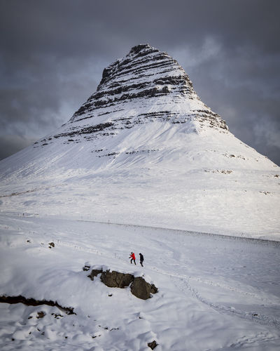 the Kirkjufell in iceland on a snowy day Ice Iceland Kirkjufell Kirkjufellsfoss Nature Travel Winter Activity Adventure Beauty In Nature Cold Cold Temperature Environment Iceland Trip Landscape Mountain Mountain Range Outdoor Outdoors Scenics - Nature Snow Snowcapped Mountain Travel Destinations Traveliceland Unrecognizable Person The Great Outdoors - 2018 EyeEm Awards