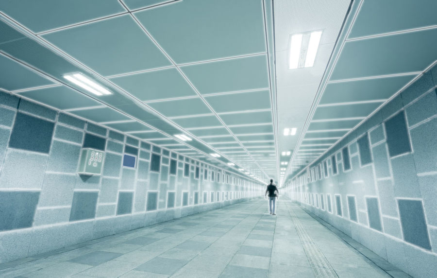Man walking through a surreal tunnel Abstract Photography Adult Architecture Built Structure Business City Conceptual Photography  Creative Photography Digital Direction EyeEmNewHere Futuristic Illuminated Indoors  Men Modern One Man Only One Person Perspective Photography Road Surreal Tech Technology The Way Forward Tunnel