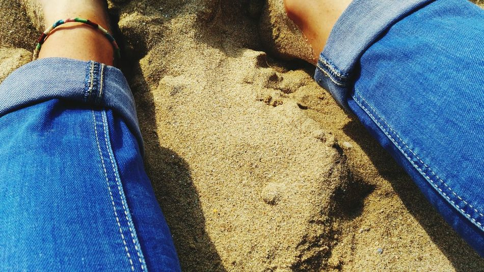 EyeEm Selects Jeans Casual Clothing Low Section Human Leg One Person Real People Leisure Activity Day Lifestyles Beach Sand Blue Close-up Men Outdoors Human Body Part Nature Adult People Adults Only