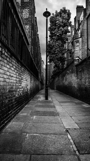 EyeEm EyeEm Best Edits EyeEm Best Shots EyeEm Selects EyeEmBestPics London Alley Architecture Blackandwhite Blackandwhite Photography Building Building Exterior Built Structure City Day Footpath Long No People Outdoors Residential District Sky Street Streetphotography Urban Wall