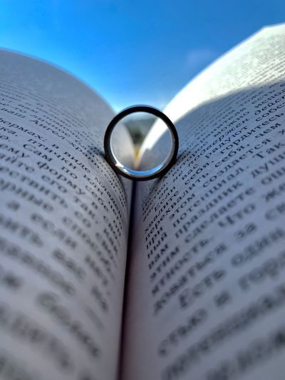 Close-up of ring in book