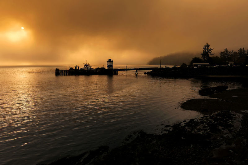 Lummi Island Ferry in the Fog. A heavy fog comes rolling in to eventually engulf the ferry dock with just a peak of sun. Water Sky Nautical Vessel Transportation Sea Nature Scenics - Nature No People Silhouette Beauty In Nature Mode Of Transportation Outdoors Ferryboat Fog Foggy Lummi Island Weather Salish Sea Puget Sound Pacific Northwest  Dramatic Landscape Morning Sunrise Dock Sun