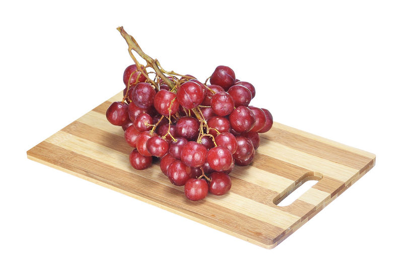crimson grape on chopping board isolated on white Agriculture Berry Bunch Crimson Crimson Grape Freshness Fruit Grape Healthy Eating Isolated On White Juice Red Tasty Toys Vegetable Vitamin
