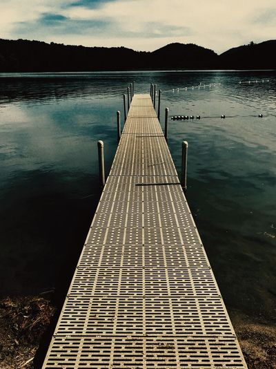 The lake Lake View Blue Sky Trees Beach Clouds And Sky Water Lake Pier Dock Water Scenics - Nature Lake Pier Nature Beauty In Nature Reflection Direction Sky The Way Forward Tranquility Tranquil Scene No People Mountain Cloud - Sky Outdoors Idyllic Diminishing Perspective
