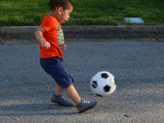 Pictures of my son playing soccer, with the shutter taking the shot at the perfect time to capture him kicking the ball. Action Shot  Childhood Kids Playing Sports Kids Sports Pictures Soccer Sports Photography Sports Pictures Toddler Sports