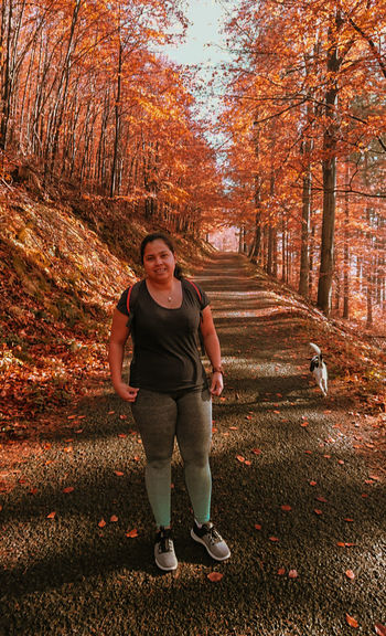 Nice walk in the forest Young Women Full Length Standing Red Hiker Autumn Collection Leaves Fall Fallen