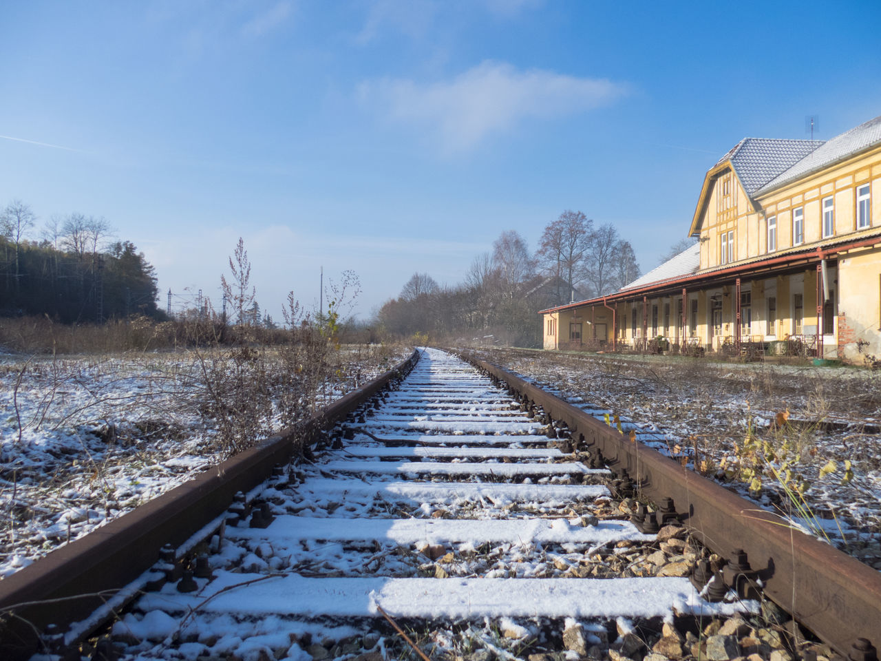 railroad track, rail transportation, transportation, the way forward, sky, no people, day, outdoors, railroad tie, nature, railroad, tree, built structure