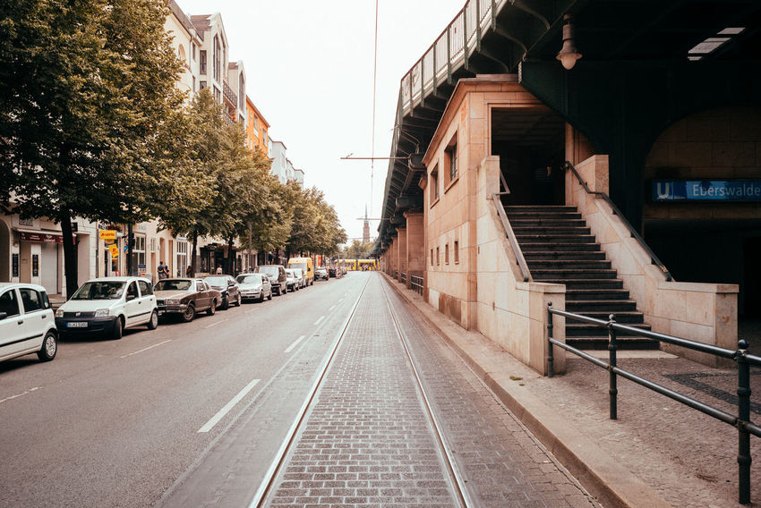Tracks perspective City City Street Public Transportation The Street Photographer - 2018 EyeEm Awards Tram Urban Geometry Architecture Building Building Exterior Built Structure Car City Day Daylight Direction Mode Of Transportation No People Outdoors Plant Road Street The Way Forward Transportation Tree Urban