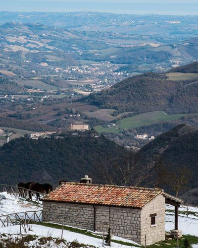 dalla montagna al mare Horses Castle Hills Sea Marche Frontone Italy Green Color Snow House Cold Temperature Building Exterior Mountain Outdoors Built Structure Landscape Nature Beauty In Nature Tree