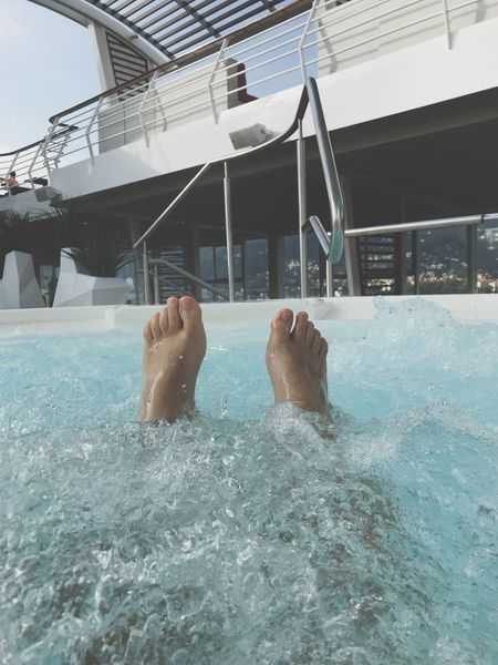 A moment in the jacuzzi. Low Section Human Leg Human Foot Water Swimming Pool Real People One Person Human Body Part Men Day Leisure Activity Lifestyles Sunlight Outdoors Relaxation Architecture Adult People