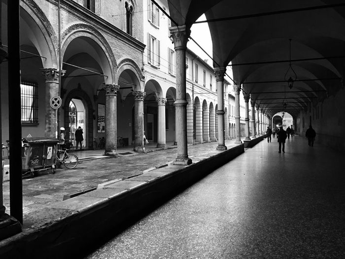 Real People Architecture Architectural Column Built Structure Men Walking Arch Lifestyles Take A Photo City Life Eyeemphoto Popular Photos Eyeem4photography Urban Exploration Blackandwhite Bw_lover Bw_collection EyeEm The Best Shots Women Building Exterior The Way Forward Indoors  Large Group Of People Day People