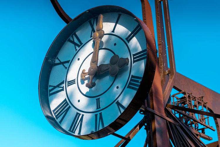 Architecture Blue Blue Sky Built Structure Circle Clear Sky Clock Clock Face Close-up Day Hour Hand Low Angle View Metal Metal Work Metalwork Minute Hand No People Outdoors Roman Numeral Sky Spiral Spiral Staircase Time