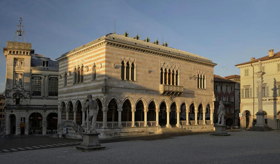 Arch Architectural Column Architectural Feature Architecture Blue Building Exterior Friuli Venezia Giulia Historic Italy Loggia Del Lionello Sunlight The Past Tourism Travel Destinations Udine