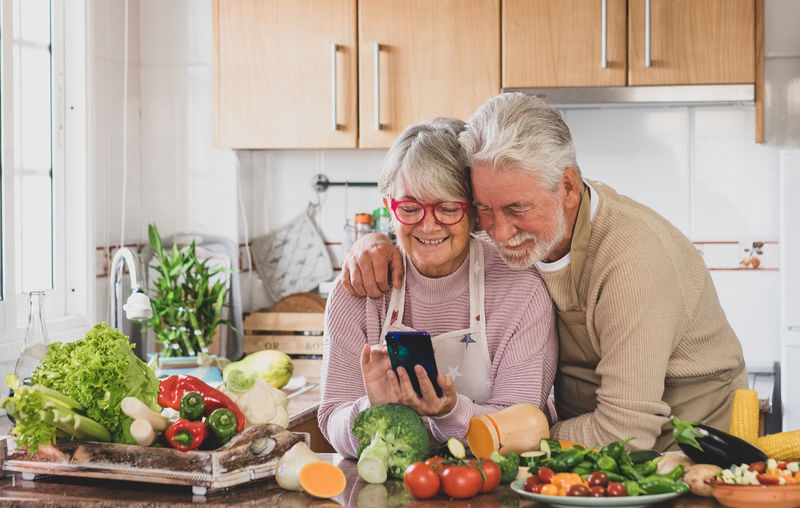 Man and woman eating food at home