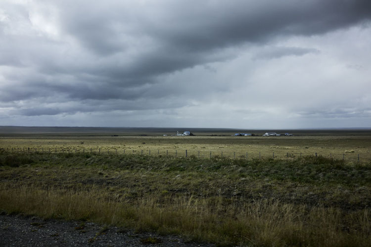 Rural Field and Overcast Sky in Patagonia Chile Cloudy Field Nature Tranquility Travel Countryside Grassland Horizon Over Land No People Outdoors Overcast Patagonia Rurual Scene South America Tranquil Scene