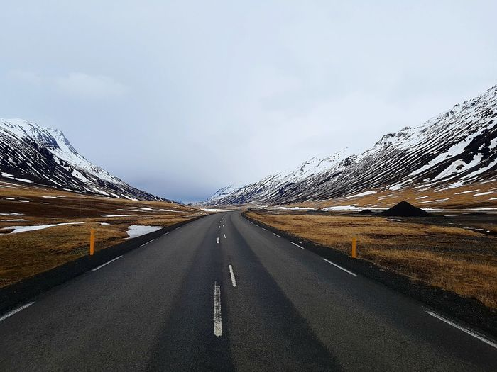 The most relaxing road Iceland Stay Out Mountain Snow Road Cold Temperature Sky Landscape Cloud - Sky Mountain Road Empty Road Rocky Mountains Road Marking