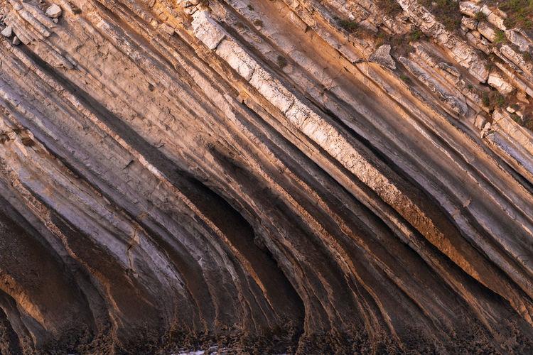 Beautiful schist cliff details in baleal island in peniche, portugal