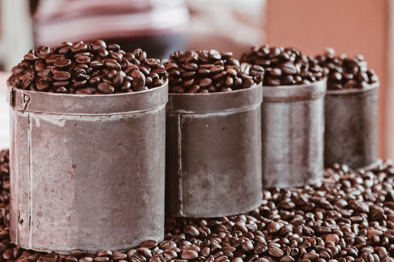Close-up of roasted coffee beans for sale in store