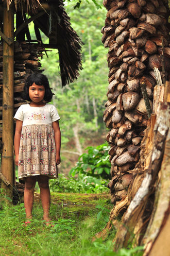 local Banten kid, with innocent face. Beauty In Nature Casual Clothing Day Focus On Foreground Front View Full Length Green Color Growth INDONESIA Kid Lifestyles Nature Outdoors Person Plant Standing Tree Young Adult EyeEm Best Shots The Portraitist - 2017 EyeEm Awards
