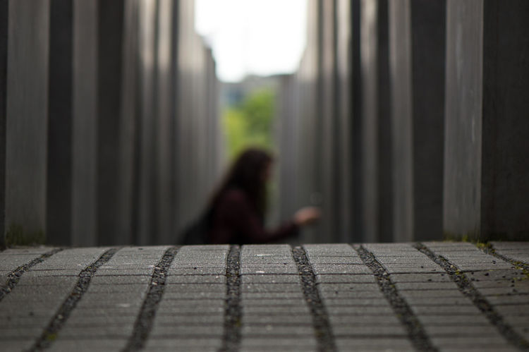 A Woman is taking a photo at the Holocaust Memorial in Berlin... One Person Selective Focus Loneliness Shadow People Adult Only Women One Woman Only Day Outdoors Full Length Defocused Shadowy Holocaust Memorial Berlin Holocaust-Mahnmal Berliner Ansichten Berlin Travel Destinations Architecture Art Arts Culture And Entertainment Low Angle View Streetphotography Capture The Moment Berlin Love
