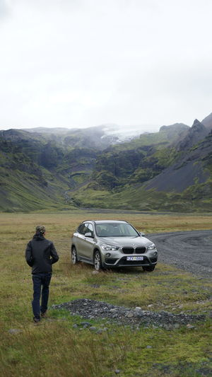 Traveller walking back to his car while travelling in Iceland Green Ice Iceland S Tranquility X3 Bmw Landscape Lifestyles Luxury Mountain Peacefull Travel Destinations Travelphotography