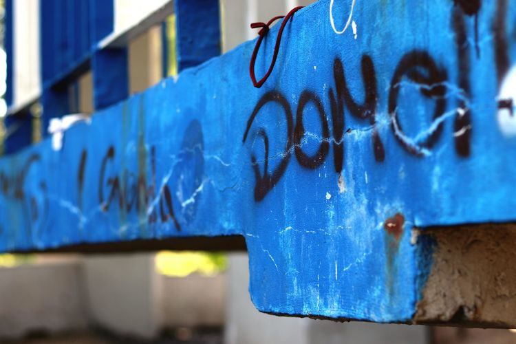 bridge blue Blue Text Graffiti Close-up Architecture Street Art Deterioration Spray Paint Obsolete Mural Weathered Shipwreck Shipwreck Aerosol Can Peeled Peeling Off Run-down Civilization Ruined Vandalism Bad Condition Damaged Abandoned Rusty