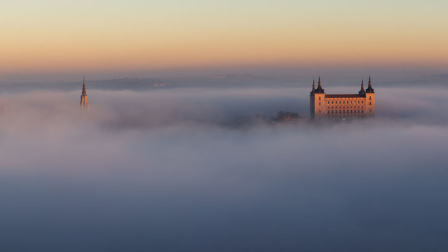 foggy morning over Toledo , Spain Toledo Sky Fog Built Structure No People Scenics - Nature Tranquility Orange Color Sunset Architecture Foggy Morning SPAIN Europe Cathedral Awesome Clods And Sky Relaxing Travel Destinations Building Travel Tower