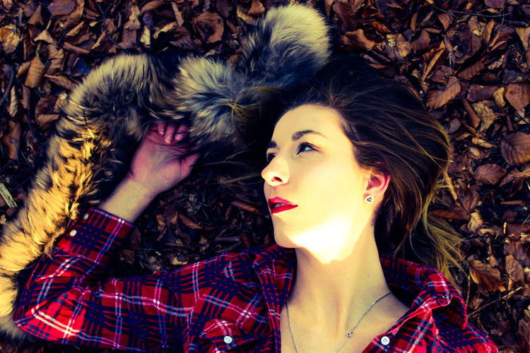 Directly Above Shot Of Young Woman Lying On Field