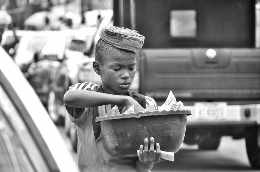 The Street Photographer - 2016 EyeEm Awards The Photojournalist - 2016 EyeEm Awards Streetphoto_bw Street Style From Around The World Street Vendor Street Traders Nigerian Street Trader Original Experiences