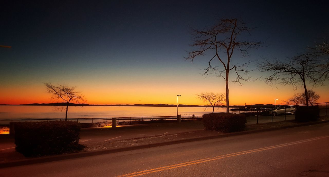 sunset, road, sky, orange color, silhouette, transportation, scenics, no people, tree, nature, beauty in nature, outdoors, tranquility, tranquil scene, sea, water, night
