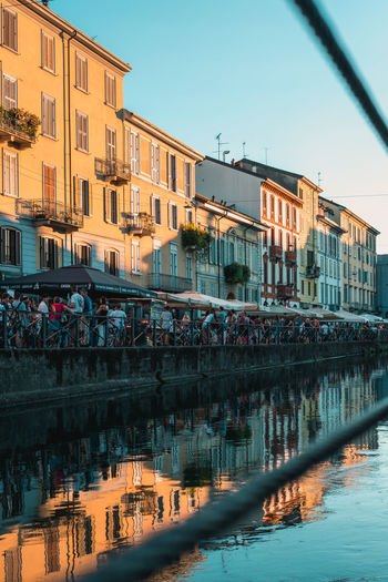 Evening Light Water Reflections Architecture Building Exterior Built Structure Caffee Caffè City Day Italy Large Group Of People Mindfulness Outdoors People Real People Reflection Sky Water Water Canal Rethink Things
